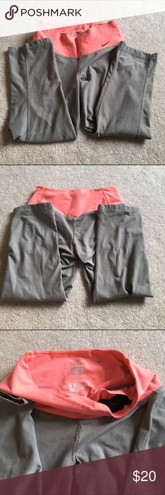 Nike Gray and Coral Legging Capris Worn quite a bit but still have life left! Right and a little higher waist. Skinny legged Capri leggings. Nike size XS Nike Pants Leggings
