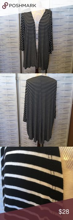 Lularoe Lindsey kimono N.079 great condition Lindsey style kimono, no holes rips or stains. It does look like throughout the garment some the material on the white stripes is showing wear shown above in the close up picture. It's not very noticeable and the only sign of wear. Price reflects. 96% rayon 4% spandex. LuLaRoe Sweaters
