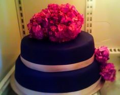 real flowers fondant covered vanilla cake and chocolate cake with a raspberry buttercream