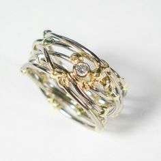 """Threads of life"" ring. White gold ring with yellow gold accents and a diamond. www.hoogenboombogers.com"