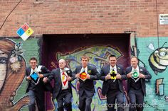 Superman groomsmen photo... Would do with Cougs, Ducks and Huskies college football shirts instead of superhero shirts