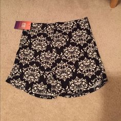 Cute black and white print shorts These are really cute and comfortable. They have stretch, but would best fit an x-small-small. NWT Shorts