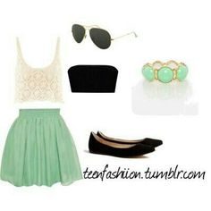 white top with a black band and a green skirt