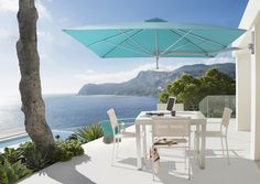The Paraflex Wall Mounted umbrella - stylish shade solution for small spaces.