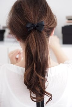 Gorgeous brown locks all tied together by a sleek black ribbon. Simple yet a powerful statement. :)