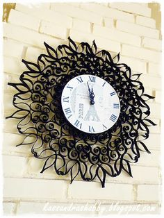 Can you believe this cast iron clock is actually made from toilet paper tubes?!  Check out the tutorial...
