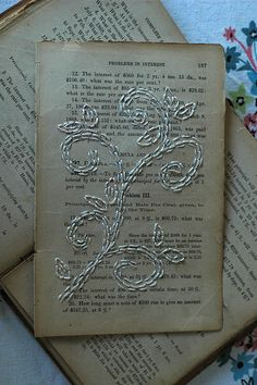"""A new """"to do"""" - embroidering on paper. Floral stitching on old book pages."""