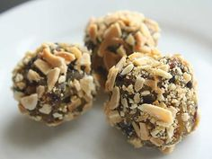 Fruit and Nut Bites. Easy for kids to make and fun for them to eat. #snacks  imply whizz together some dried fruit in a food processor to make a moldable paste that little hands can roll into balls and cover in chopped, toasted nuts. Make a big batch over the weekend and you'll have healthy snacks all week long!