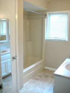 "Before & After: The Under $250 ""Work With What We've Got"" Bathroom Refresh — Renovation Project"