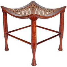 Liberty & Co. / Leonard Wyburd Egyptian Revival Four-Legged Mahogany Thebes Stool Circa 1890-95 | From a unique collection of antique and modern stools at http://www.1stdibs.com/furniture/seating/stools/