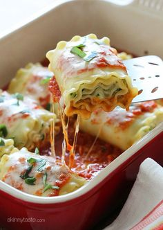 3-Cheese Zucchini Lasagna Rolls Servings: 8 • Size: 1 roll Calories: 240 • Fat: 8 g • Carb: 27 g • Fiber: 2 g • Protein: 13 g • Sugar: 2 g Sodium: 292 mg • Cholest: 38 mg Ingredients: 8 lasagna noodles, cooked 1 tsp olive oil 3 cloves garlic, crushed 2 med zucchini, grated and dried 1 cup + 2 tbsp ricotta cheese 1/2 cup Parmesan cheese 1 lg egg, beaten 1/2 tsp salt pepper 1 3/4 cups Marinara sauce 1/2 cup part skim mozzarella cheese, shredded fresh basil for garnish (optional)