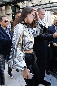 Security: Bella was surrounded by bodyguards, after her sister Gigi Hadid was assaulted by...