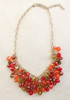 "Autumn Sunrise Beaded Necklace 24.99 at shopruche.com. This golden chain is dripping with shimmering beads in candy colored hues of green, red, and peach.19"" long, Adjustable closure"