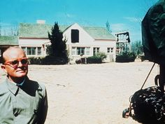 """Truman Capote photographed outside the Clutter family home in The window of the house is blacked out with cloth, as filming was taking place for the film """"In Cold Blood"""" inside the house at the time. Famous Murders, Book Presentation, John Wayne Gacy, True Crime Books, In Cold Blood, Harper Lee, Clutter, Kansas, History"""
