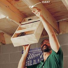 pivoting boxes that hang between the ceiling joists. When a drawer is down, you have easy access to its contents