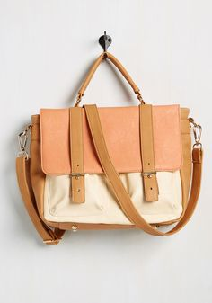this faux-leather tote's golden accents, pockets, and soft tan, apricot, and ivory hues earn the highest marks in style.