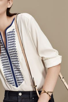 Ann Taylor's gold cuff casts a warm glow on this gorgeous graphic tunic.