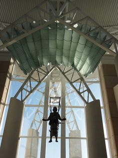 A paratrooper hangs overhead at the Airborne and Special Operations Museum in historic downtown #FayettevilleNC