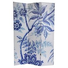 """Three-panel room divider with a reversible floral motif.  Product: Room dividerConstruction Material: Wood and canvasColor: White and blueFeatures:  Three foldable panelsBlocks light and provides privacy Dimensions: 71"""" H x 47.63"""" W x 1"""" D"""