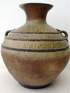 "A Western Han dynasty (206 BC) olive green-glazed ""Yue Ware"" storage jar. Southern clay requires firing at a relatively high temperature, and this olive-green glaze is a side effect of the minor impurities in the clay and wood ash mixture used at the time. Its speculated that this would have been used to store wine. This piece comes with Thermoluminescence (TL) test certificate. For sale. More details at http://www.antique-chinese-furniture.com/blog/?p=2294"
