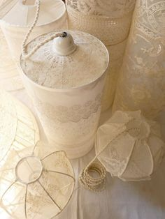 Lacy Lanterns - no DIY here, just more pics of lace covered lamp shade frames. gives me an idea though... what if I used a clear plastic bottle/jug cut down to the skeleton shape of a shade?