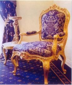 A truly Magnificent chair originally made as a set of six by Nicholas Heurtaut C. 1760 for the boudoir of Marie Antoinette wife to King Louis XVI of France. These chairs can still be seen in the restored palace today. This, a superb, exact copy, is illustrated in 23ct gold water gilding as the originals