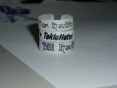 Shrink plastic rings with text. Very cool