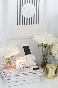 feminine home decoration: vintage phone holder, scented candle, white roses, ...