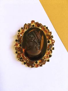 See new listings daily - follow us for updates.  Large #Vintage Glass #Cameo Brooch - Vintage Rhinestone Brooch - Gold Tone Brooch - Glass Cameo - Rhinestone Brooch - Vintage #Jewelry - Offered by MimisJewelryBoutique  Color... #vintage #jewelry #teamlove #etsyretwt #bestofetsy #cameo #brown #orange #mimisjewelryboutique #oval ➡️ http://jto.li/Ct8XY