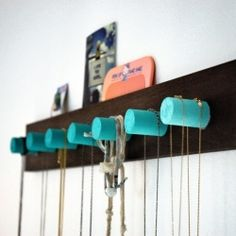 A simple, modern jewelry organizer for a clean display with pops of color. Craftgawker