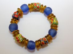 This stretch cord bracelet includes all recycled glass Krobo beads made in Ghana, West Africa: All proceeds go to help build the computer lab at SDA School in the village of Ankaase. Size: medium (7 1/2 inches around) $20. www.armsaroundankaase.storenvy.com