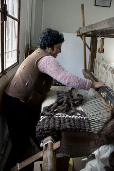 *this looks like wool roving is being used to create a luxuriously thick rug...