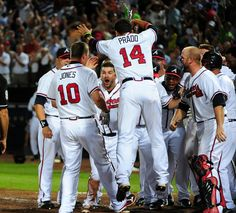 Atlanta Braves with #10 Chipper Jones celebrates the walk off home run