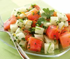 "Juicy Watermelon & Jicama Salad •1/2 cup fresh orange juice   •1 teaspoon orange zest   •1 teaspoon lime zest  •2 tablespoons honey   •1 tablespoon olive oil   •1 Teaspoon freshly ground black pepper   •Sea salt   •1 jicama, peeled and diced   •4 cups PureHeart Mini Seedless Watermelon, cut in 2"" chunks   •1/3 cup cilantro, chopped   •1/2 jalapeño pepper, finely diced"
