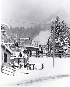 """1959 - Ski Broadmoor in Colorado Springs, CO is dedicated. It is a pioneer of innovation, boasting lights for night skiing and a $200,000 snow making machine known as the """"Phenomenal Snowman"""", the first of its kind west of the Mississippi. A double chair lift can carry 600 people an hour."""