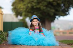 Say hello to the beautiful Sienna! This kids completely lights up the room and we had so much fun styling her for this colourful portrait session.