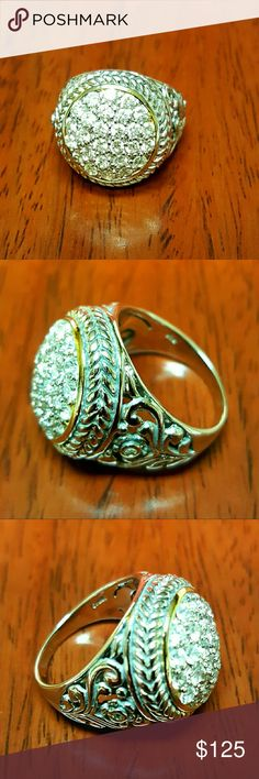 EUC STERLING SILVER 14K ACCENT CZ CLUSTER RING Excellent pre-loved condition ladie's cocktail beautiful sterling silver large round design ring accented with a thin band of 14kt gold around cluster of brilliant CZ stones in a has narrow shank. PRICE IS FINAL! NO OFFERS NO TRADES NO RETURN OR EXCHANGE. Lmkdeals Sterling Silver  Jewelry Rings