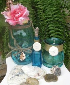 I added These Lovelies from With a Dash of Color  to Ways to Decorate Jars and Bottles Beach Style.