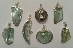Ancient glass shards believed to be approximately 4,500 years old are wire wrapped into pendants with 14KGF and sterling silver.