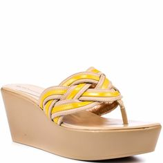 Get cute and comfy in this new sandal by BCBG. A beige 3 inch wedge and 1 1/2 inch platform coincide to deliver a no stress height. A bright yellow patent weaves through the vamp to create this adorable thong style.