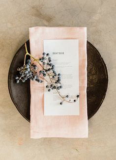 simple setting: linen napkin, berry vine, menu