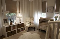 gender neutral nursery - love the drapes and the chrome dresser changing table.