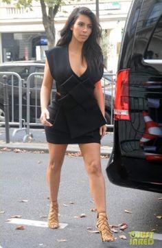 Kim Kardashian wearing Hermes Strappy Sandals and A.W.A.K.E. Fall 2014.