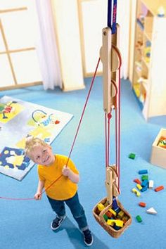 This is a crazy toy...a pulley to teach kids mechanics. (Make one for outside at the kids fort)