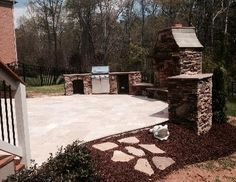 Travertine patio with outdoor fireplace and outdoor kitchen