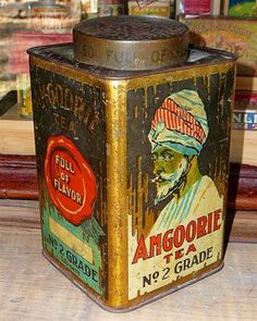 "Amgoorie Tea No.2 Grade tea tin ... depicts Indian man in turban and slogan ""Full of Flavor"" on red seal on adjoining sides, rectangular with cap lid, early 20th century"