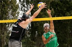 Switzerland's Alexei Strasser (left) and Italy's Adrian Ignacio Carambula Raurich duel at the net
