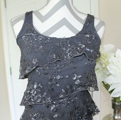 Express grey lace tank top Very cute top, perfect for a girly or professional look. Charcoal grey with ruffle metallic lace front and back. Worn once! Express Tops Tank Tops