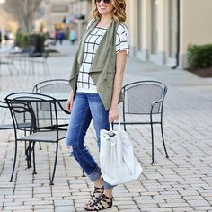 Perfect combo, perfect look. We love how @styleunder40 paired her T.J.Maxx olive green vest with a fun print!