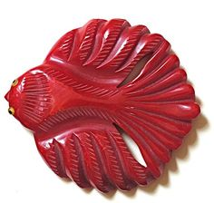 red carved bakelite fish brooch